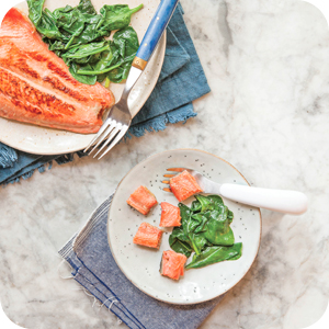 Image of Honey-Glazed salmon with sautéed spinach on a 2 plates.