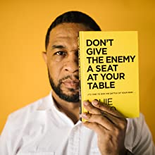 man holding don't give the enemy a seat at your table