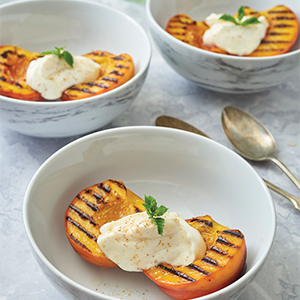 3 bowls of halved & perfectly grilled peaches topped with whipped ricotta.