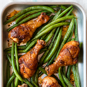 Large pan of oven paprika backed chicken with green string beans.