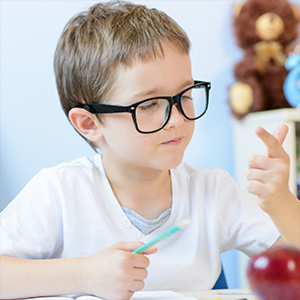 Child counting numbers on his fingers