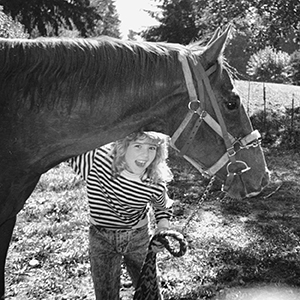 Photo of young Brandi Carlile and her horse